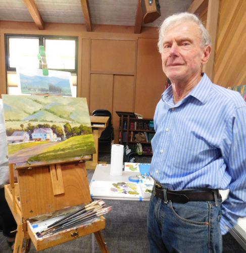 Artist Ed Lucey stands in his studio
